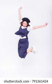 Beautiful Asian woman jumping or flying isolated on white background (selective focus on her face)