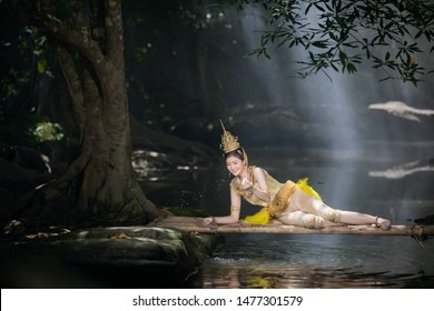 Beautiful asian woman in KINNARY costume thailand art concept playing water