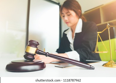 Beautiful asian woman lawyer working and gavel in front, Advice and Legal services Concept.
