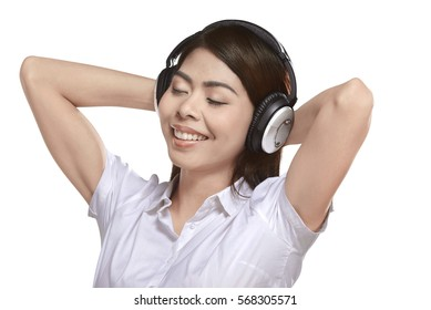 Beautiful asian woman listening music with headphone isolated over white background