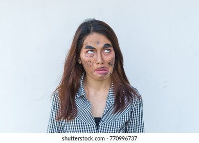 Beautiful asian woman make up face joke on white background,Thailand people pose for take a picture