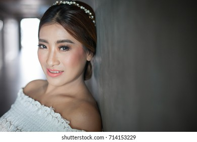 beautiful asian woman with make up and hair style for bride