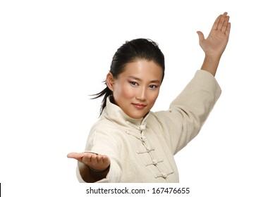 Beautiful asian woman make kung fu gesture  on white