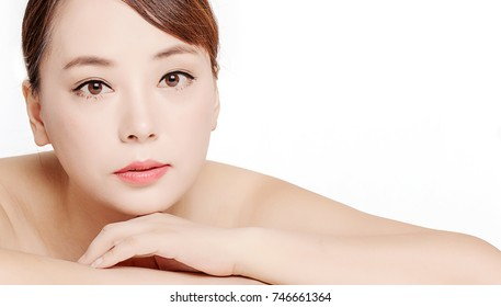 Beautiful asian woman with makeup in front of white background