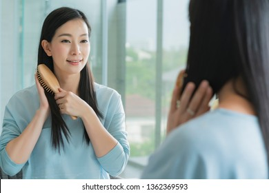beautiful asian woman makeup and hair set wirh mirror in bathroom with morning light