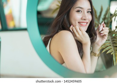 beautiful asian woman nice smile and healthy skin with green leaf tree portrait