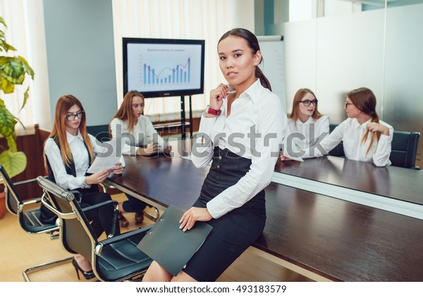 Beautiful asian woman on the background of business people