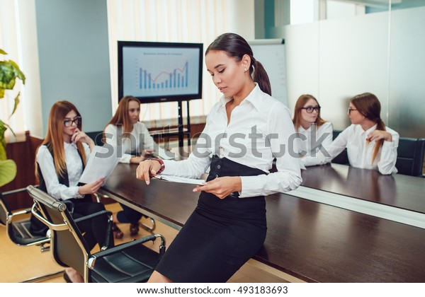 Beautiful asian woman on the background of business people and studying documents