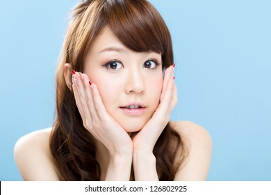 Beautiful asian woman on blue background