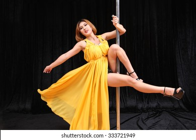 Beautiful Asian woman pole dancer