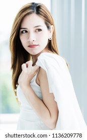 beautiful asian woman portrait image in white elegance dress white room background