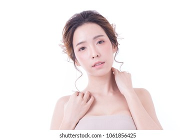 Beautiful Asian Woman Portrait. Beautiful Woman looking to camera. Korean Woman Touching her Face. People with Youth and Skin Care Concept. isolated on white background.