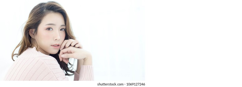 Beautiful Asian Woman Portrait. Beautiful Woman looking to camera. Korean Woman Touching her Face. People with Youth and Skin Care Concept. isolated on white background. with banner size