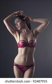 Beautiful Asian woman posing in soft light