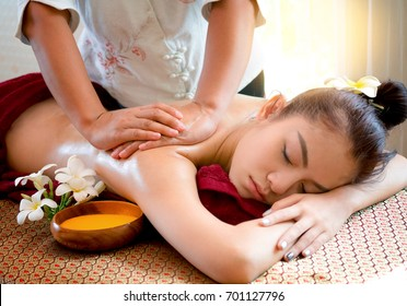Beautiful Asian woman receiving massage in spa salon,Healthy Lifestyle
