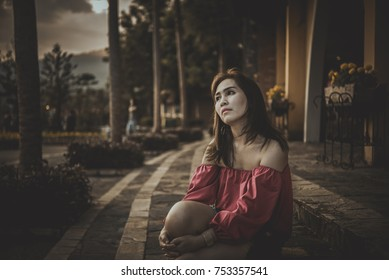 Beautiful asian woman sad from love,Thailand girl heartbreak from lover,Stress asia woman sit and thinking about the past,Lonely girl concept