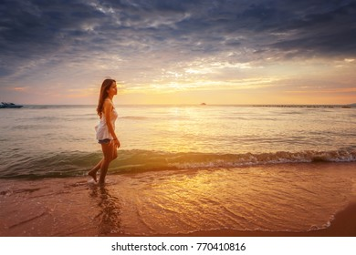 Beautiful asian woman with a short jeans travel and relax at beach in vacation