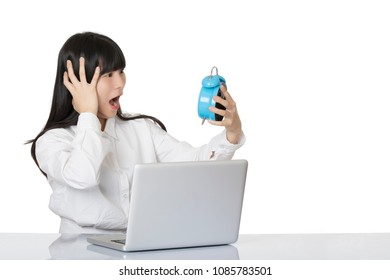 Beautiful Asian woman sitting at desk very stressed out about a dead line isolated on a white background