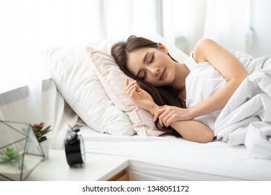 Beautiful Asian woman sleeping on her bed at her bedroom.