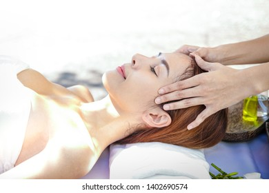 Beautiful Asian woman sleeping in the spa To let the massage staff relax