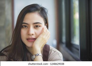 Beautiful Asian woman smiling indoors