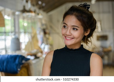 Beautiful Asian woman smiling indoors