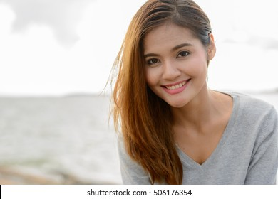 Beautiful Asian woman smiling outdoors