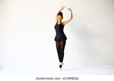 Beautiful Asian woman standing in ballet position on the tip of the toes.