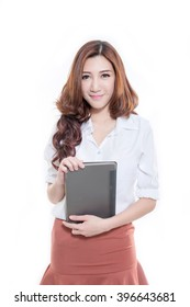 Beautiful Asian woman standing , holding tablet computer
