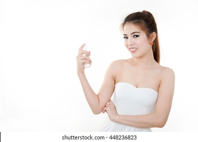 Beautiful asian woman standing , holding spray bottle