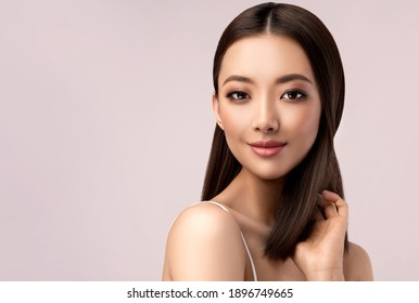Beautiful Asian woman with  straight hair. Beauty Chinese  girl with clean and white skin. Fashion, cosmetics and makeup