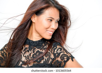 Beautiful asian woman in tan skin portrait with white background.