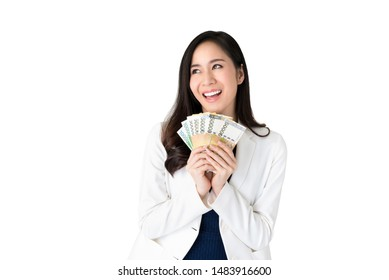 Beautiful Asian woman thinking and smiling while holding South Korean won money in hands isolated on white background