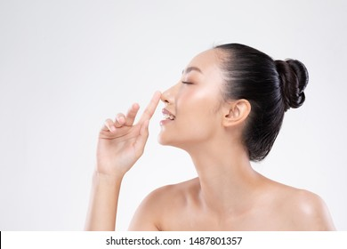 Beautiful Asian woman touching nose smile with clean and fresh skin Happiness and cheerful with positive emotional on white,Plastic Surgery nose,Beauty Cosmetics and spa facial treatment Concept