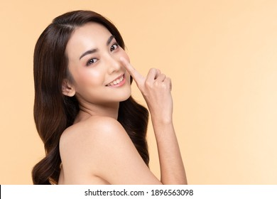 Beautiful Asian woman touching nose smile with clean and fresh skin Happiness and cheerful with positive emotional on Beige,Plastic Surgery nose,Beauty Cosmetics and spa facial treatment Concept - Shutterstock ID 1896563098
