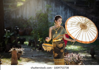 Beautiful asian woman in traditional costume at temple, Laos woman