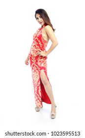Beautiful Asian woman in traditional red Chinese dress side split, QiPao, Cheongsam or Mandarin gown isolated on white background.