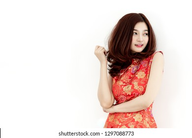 Beautiful Asian woman in traditional red cheongsam costume dress smile and feel happy to celebrate Chinese new year in white background