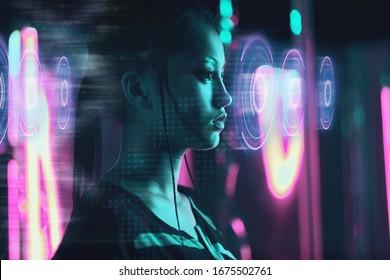 Beautiful asian woman using futuristic computer screen in neon light - Shutterstock ID 1675502761