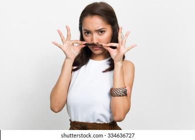 Beautiful Asian woman using her hair to make mustache