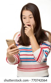Beautiful Asian woman using a smart phone to send a text message isolated on a white background