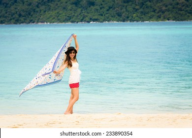 Beautiful Asian woman vacation on beach of Thailand. Lipe island, Andaman sea.