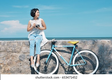 Beautiful Asian woman with vintage bicycle and vintage camera,travel concept