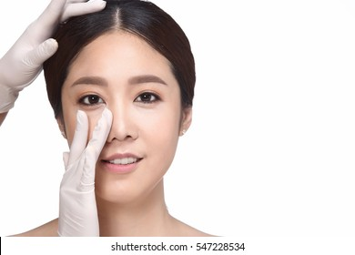 Beautiful Asian woman want to check nose before plastic surgery rhinoplasty, white background copy space for text logo