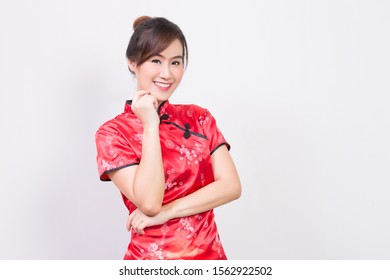 Beautiful Asian  woman wearing cheongsam traditional red dress for Chinese new year day 2020 isolated on white background with copy space   Chinese New Year 2020 concept.