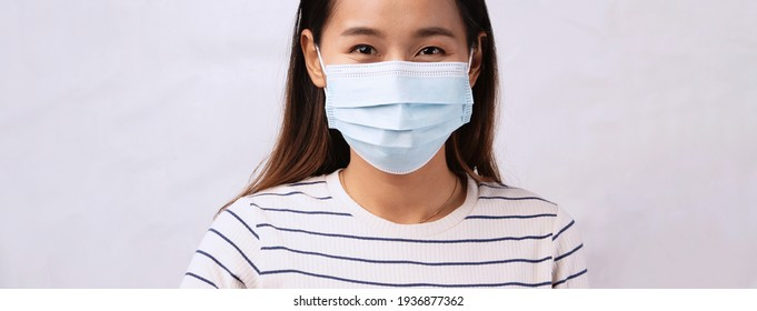 beautiful Asian woman wearing mask protection virus corona or covid19. healthy care concept