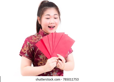 Beautiful asian woman wears cheongsam on white background. Holding red envelopes and smile in chinese new year.