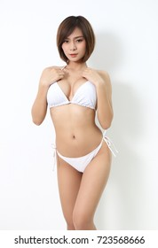 beautiful asian woman in white bikini in studio