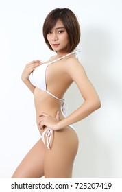 beautiful asian woman in white bikini in studio