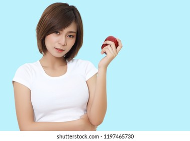beautiful asian woman with white cloths holding apple on her hand